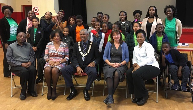Group photo of Reading charity CCI and Karen Morton chair of Reading Area Charities Together